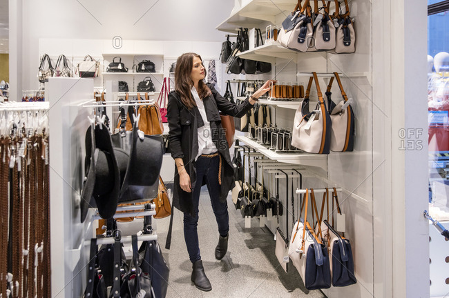 Sweden, Woman choosing purse in shop