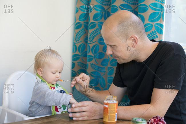 Sweden, Father feeding baby son