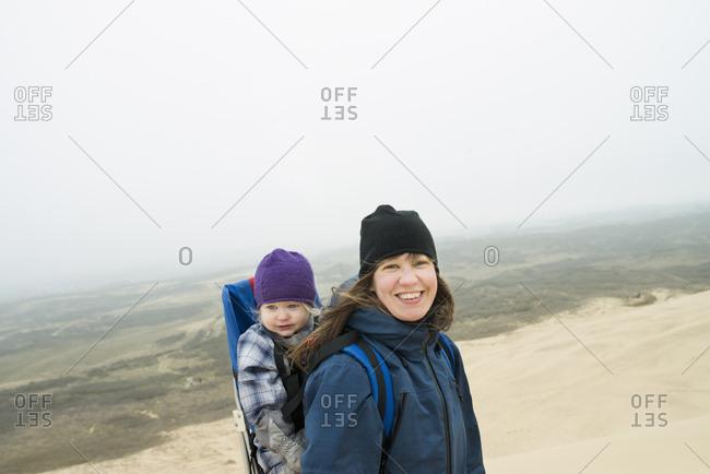 Denmark, Nordjylland, Portrait of mother and daughter against foggy landscape