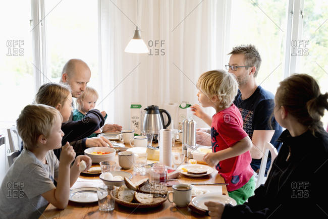 Sweden, Family with children eating breakfast at table