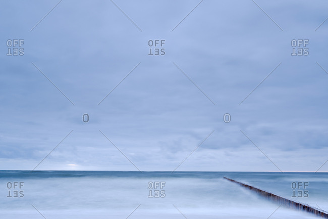 Poland, Niechorze, Seascape with breakwater under moody sky