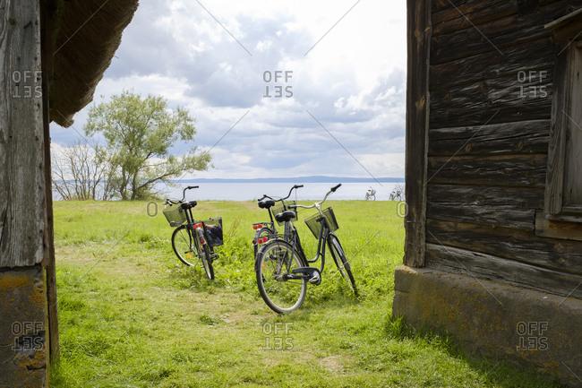 Sweden, Smaland, Visingso, Vattern, Bicycles near old hut at lake side