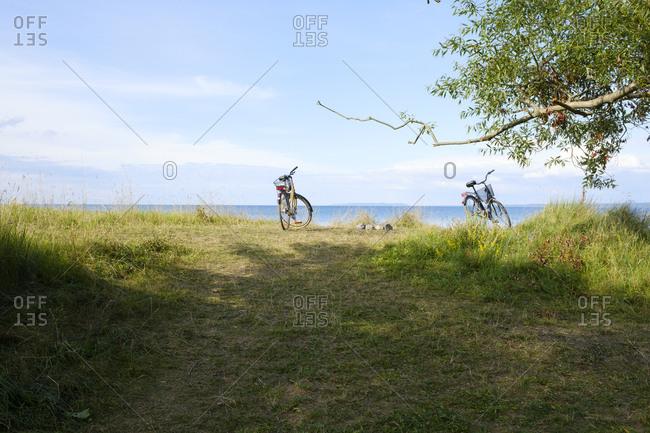 Sweden, Smaland, Visingso, Vattern, Bicycles at lake side