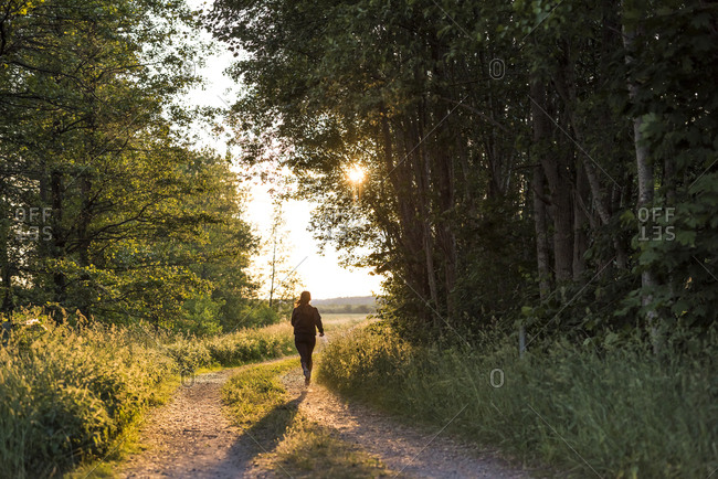 Sweden, Sodermanland, Stigtomta, Teenage girl jogging in forest