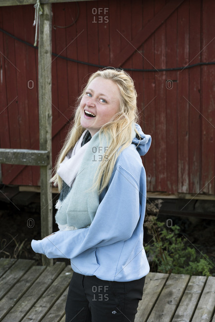 Sweden, Sodermanland, Hummelvik, Portrait of young blonde woman laughing