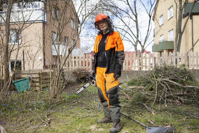 Sweden, Sodermanland, Portrait of standing arborist