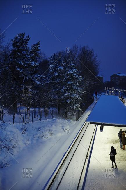 Sweden, Sodermanland, Stockholm, Johanneshov, Skarmabrink, railroad track in winter