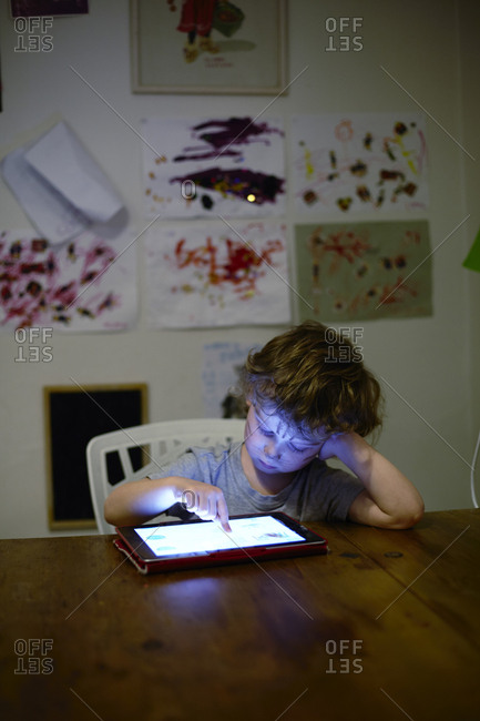 Sweden, Boy playing on digital tablet