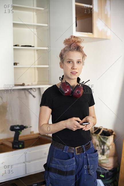 Sweden, Portrait of mid adult woman carpenter
