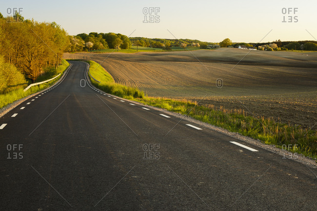 Sweden, Skane, Rockarp, country road in rolling landscape