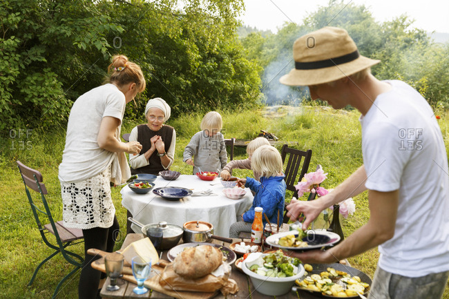 Sweden, Sodermanland, Jarna, Family with baby girl and boy having picnic