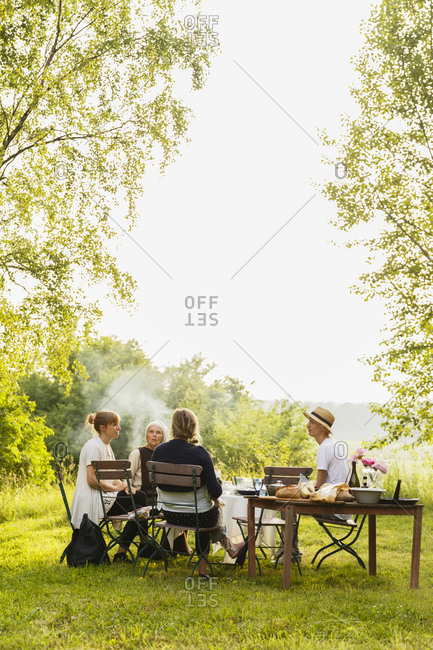 Sweden, Sodermanland, Jarna, Family with baby girl having picnic