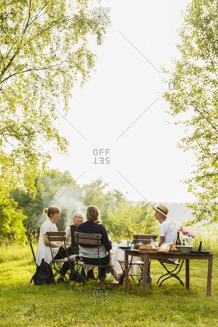 Sweden, Sodermanland, Jarna, Family with baby girl having picnic