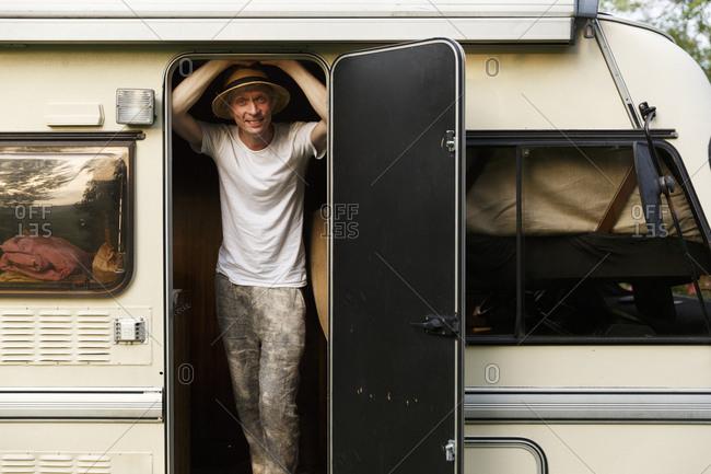 Sweden, Man standing in doors of trailer home