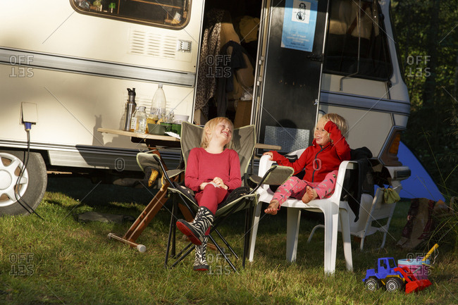 Sweden, Sodermanland, Trosa, Kids laughing in front of trailer home