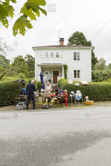 Sweden, Sodermanland, Jarna, Grandparents with grandchild preparing flea market