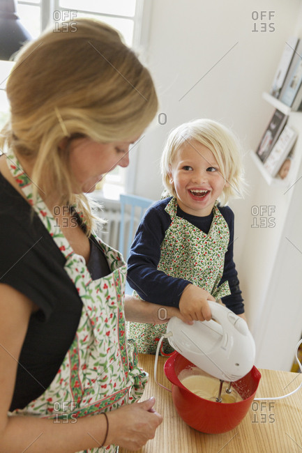 Sweden, Boy cooking with mother
