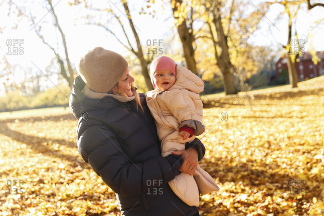 Sweden, Mother with child in public park in autumn