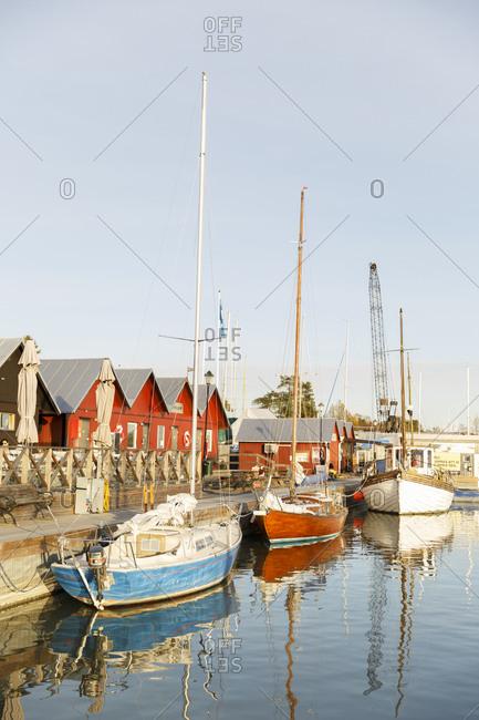 Sweden, Sodermanland, Trosa, Old sailboats on riverbank