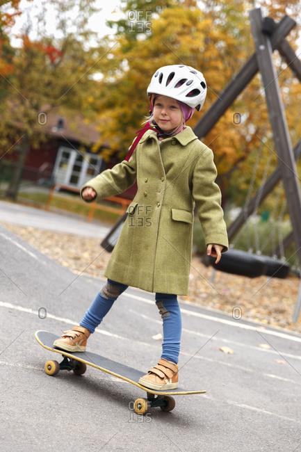 Sweden, Sodermanland, Jarna, Girl riding skateboard in skatepark