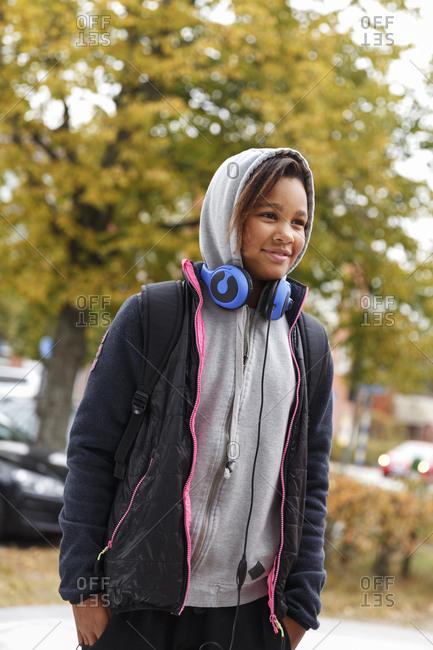 Sweden, Sodermanland, Jarna, Girl in hoodies with headphones