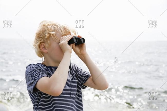 Sweden, Stockholm Archipelago, Sodermanland, Orno, Boy looking through binoculars