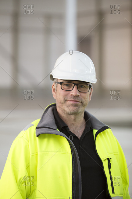 Sweden, Portrait of engineer in helmet and reflective clothing
