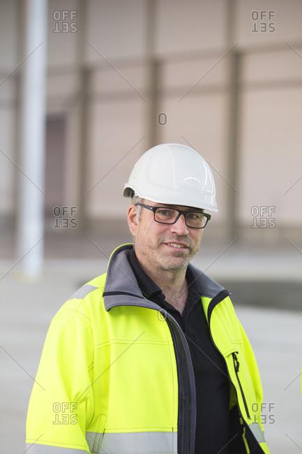 Sweden, Portrait of man wearing reflective jacket and helmet