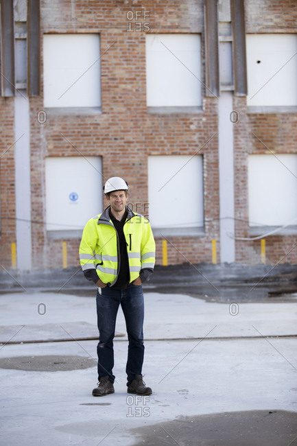 Sweden, Portrait of man with building in background