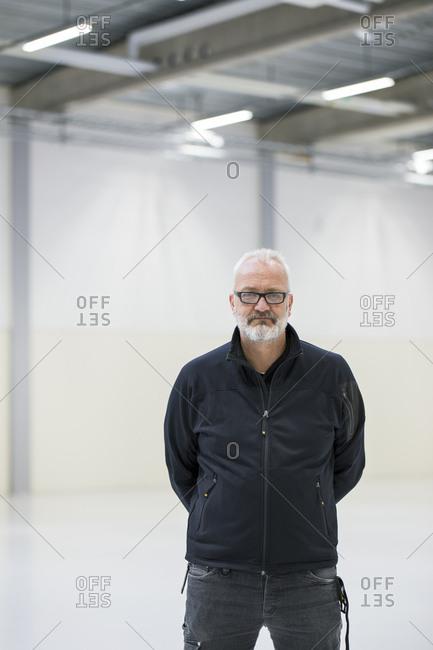 Sweden, Portrait of mature man in industrial hall