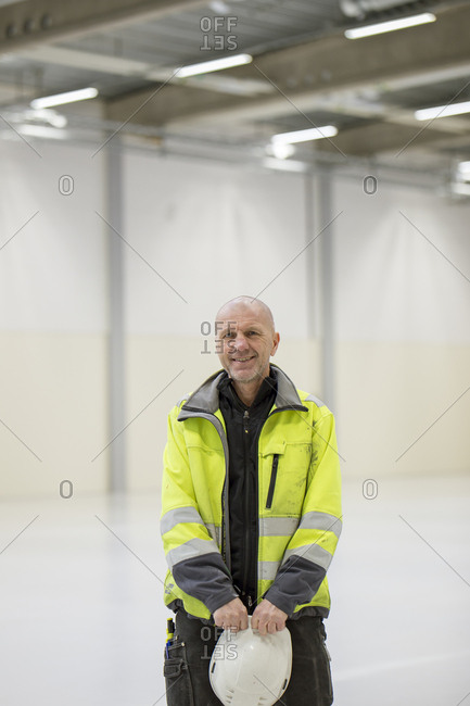 Sweden, Mature man wearing protective workwear in industrial hall