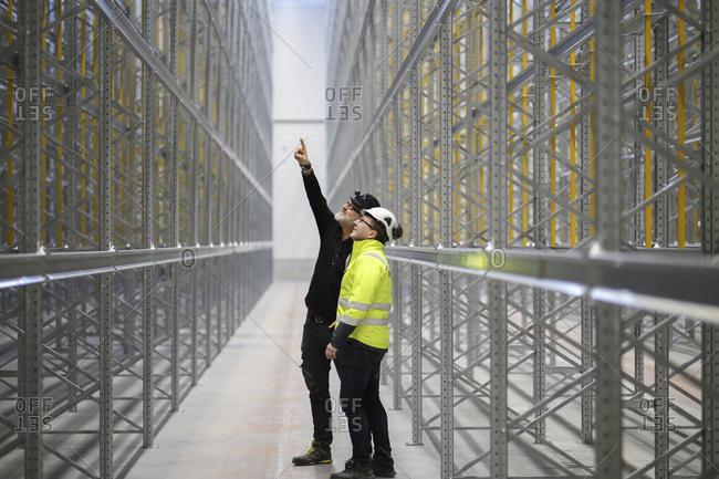 Sweden, Mature men at construction site