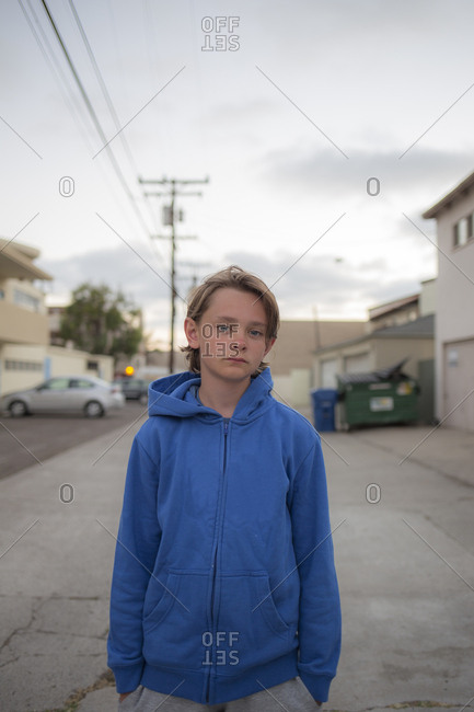 USA, California, San Diego, Portrait of boy wearing blue hoodie