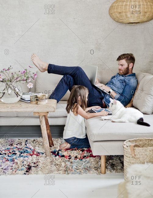 Sweden, Father and daughter in living room