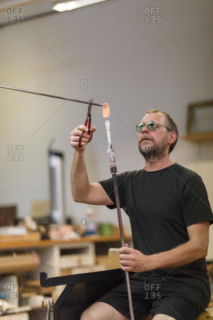 Sweden, Man working in workshop