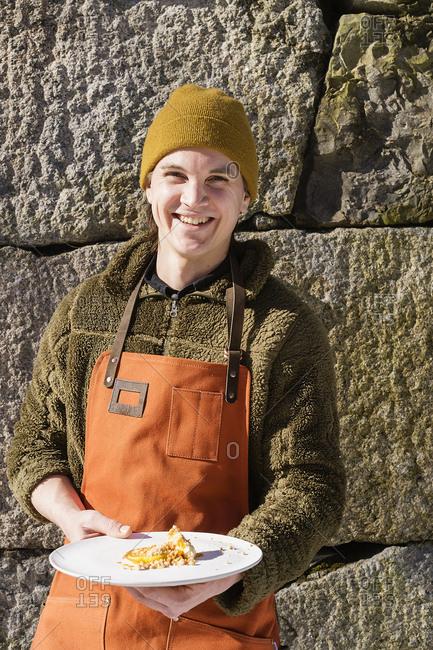 Sweden, Vastmanland, Man with dish