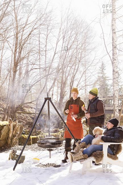 Sweden, Vastmanland, People having barbecue