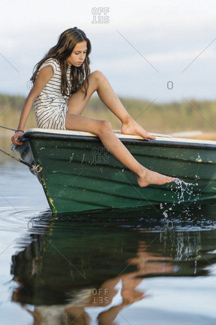 Sweden, Vastmanland, Hallefors, Bergslagen, Portrait of girl sitting on boat