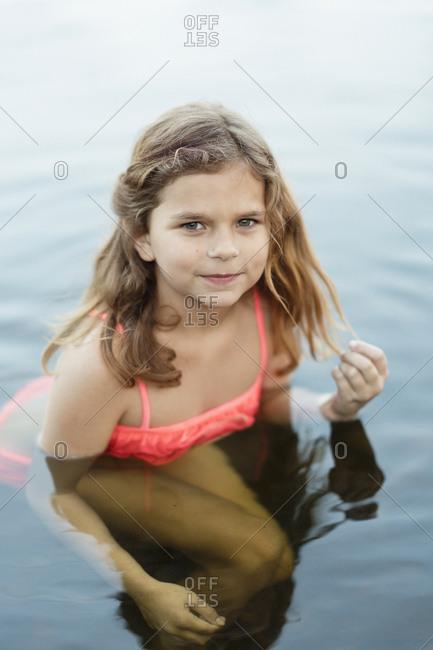Sweden, Vastmanland, Hallefors, Bergslagen, Portrait of smiling girl in lake