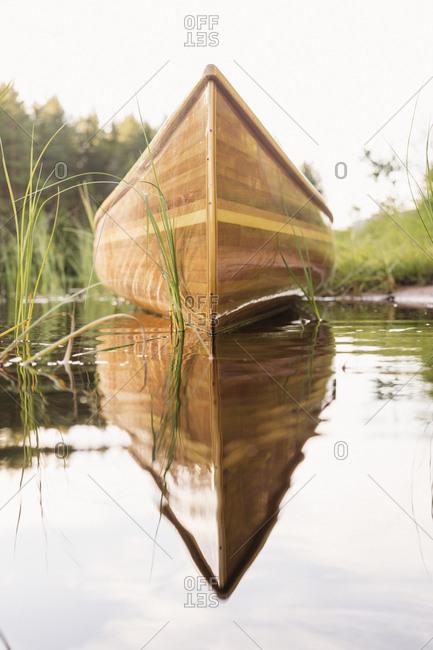 Sweden, Vastmanland, Hallefors, Bergslagen, Wooden rowboat on lakeshore