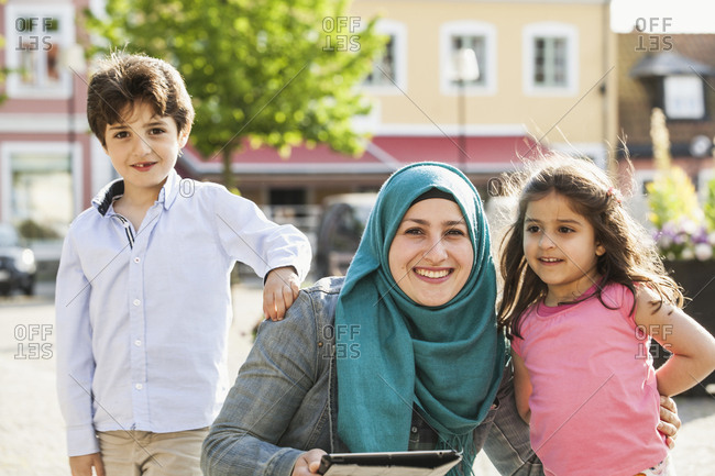 Sweden, Blekinge, Solvesborg, Portrait of mother with son and daughter on town square