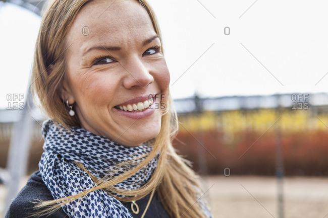 Sweden, Blekinge, Solvesborg, Portrait of smiling mid adult woman