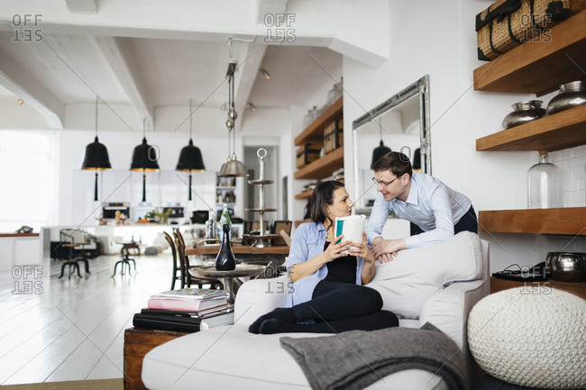 Germany, Mature couple talking in living room