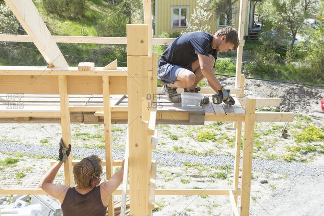 Sweden, Sodermanland, Carpenters working on construction site