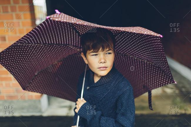 Sweden, Blekinge, Karlskrona, Portrait of boy holding umbrella