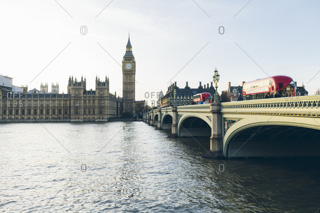 England, London - December 22, 2016: Houses of Parliament and Westminster Bridge seen across River Thames