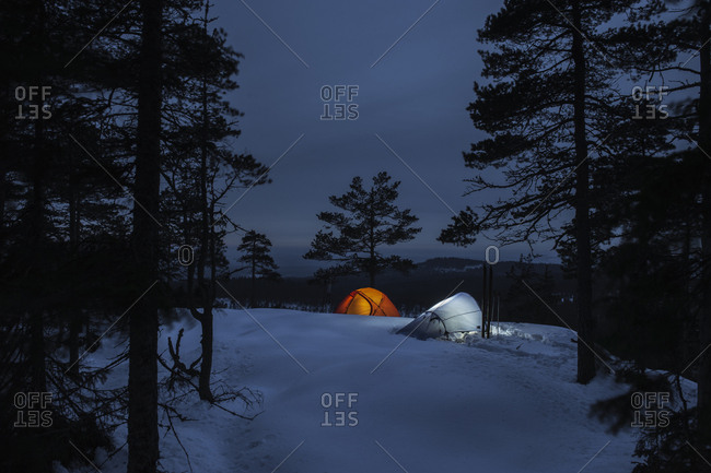 Sweden, Vastmanland, Kindla nature reserve, Two tents among trees at night