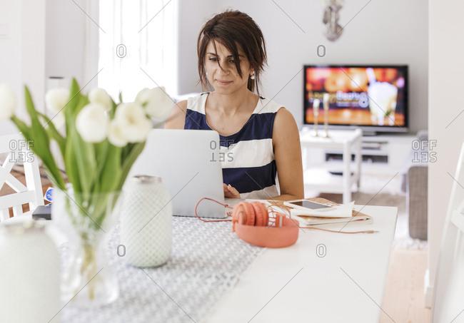 Sweden, Woman using laptop