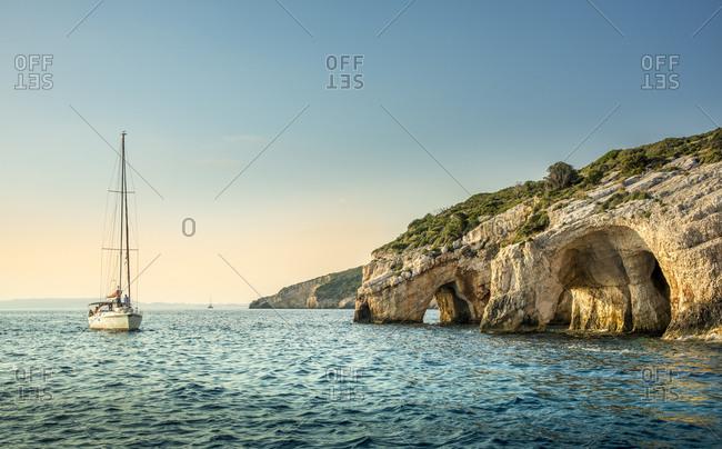 Greece, Megansi, Yacht sailing along coastline