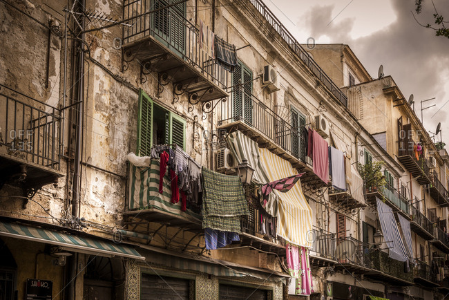 Italy, Sicily - November 10, 2016: Clothes hanging on balconies